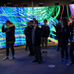 Indigenous students stand inside a human brain simulation